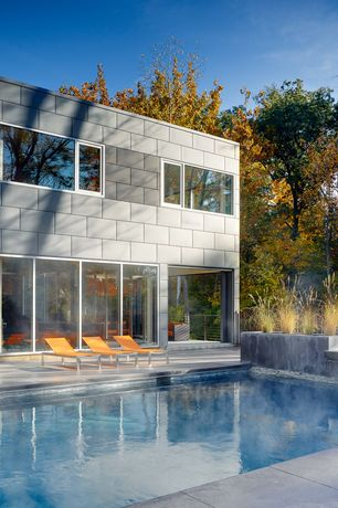 Contemporary Swimming Pool with exterior tile floors, Lap pool