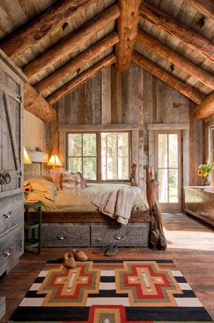 Rustic Guest Bedroom with French doors, Hardwood floors, Cathedral ceiling, Built-in bookshelf, picture window, Wall sconce