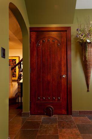 Craftsman Hallway with specialty door, Custom Door Store Custom Two-Panel Door Arched Top V Grooved Panels And Clavos