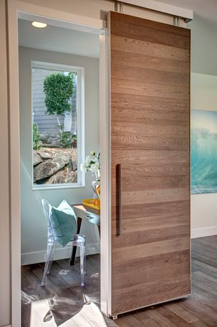 Modern Home Office with Barn door, Hardwood floors