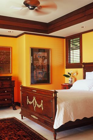 Tropical Master Bedroom with Built-in bookshelf, can lights, Standard height, Carpet, Ceiling fan, Casement