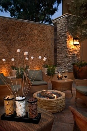 Contemporary Patio with exterior stone floors, Trellis, Fence, Fire pit, Raised beds
