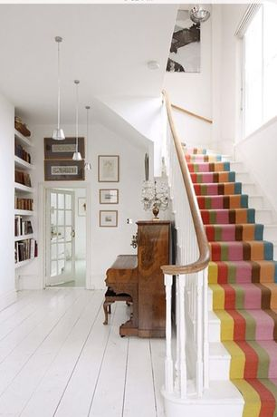 Traditional Staircase with Pendant light, curved staircase, High ceiling, Casement, Hardwood floors