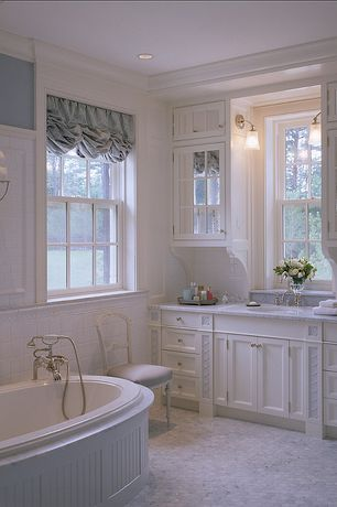 Cottage Master Bathroom with Master bathroom, can lights, Limestone counters, drop in bathtub, Wood paneling, full backsplash
