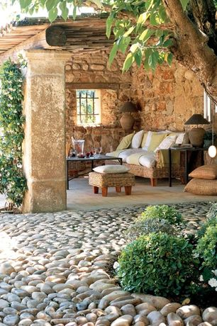 Rustic Porch with exterior stone floors, specialty window
