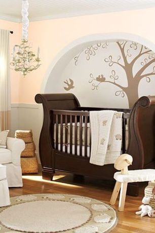 Traditional Kids Bedroom with PB Kids Comfort Swivel Rocker & Ottoman, Crown molding, Chandelier, Hardwood floors, Mural