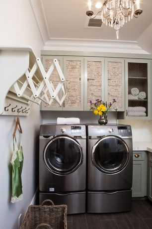 Cottage Laundry Room with Hardwood floors, Built-in bookshelf, Crown molding, Chandelier, Danyab accordion drying rack
