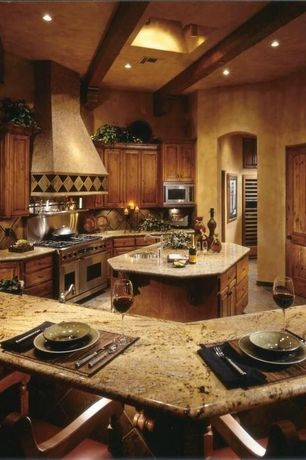 Eclectic Kitchen with Complex granite counters, Stone Tile, Pental gold antique polished granite, Under cabinet lighting