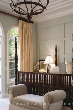 Traditional Guest Bedroom with Carpet, Arched window, Crown molding, Standard height, French doors, Chandelier