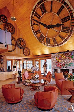 Eclectic Living Room with Fireplace, stone fireplace, Pendant light, Laminate floors, flush light, Cathedral ceiling, Loft