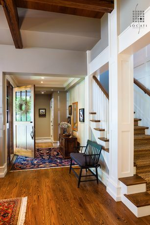 Traditional Entryway with Glass panel door, Hardwood floors, Columns, Crown molding