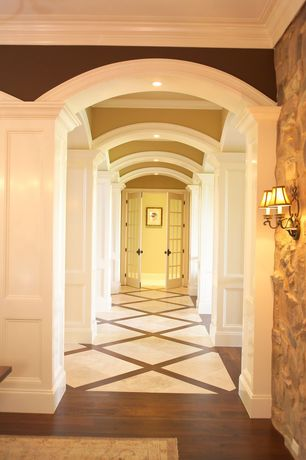 Traditional Hallway with Hardwood floors, Wall sconce, Crown molding, French doors, Columns, Wainscotting