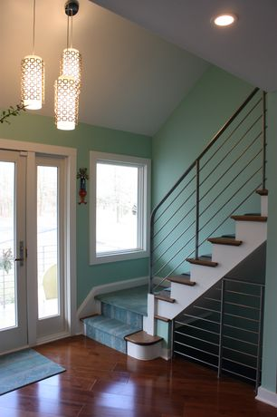 Contemporary Entryway with Casement, French doors, Pendant light, High ceiling, can lights, Hardwood floors