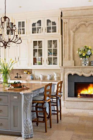 Country Kitchen with French country, Glass front cabinets, Ceiling height cabinets, Cabinets, Limestone fireplace