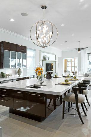 Traditional Kitchen with Quartz countertop, limestone tile floors, Undermount sink, Kitchen island, Corian- Designer White