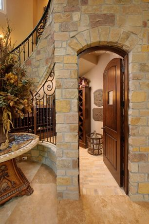 Mediterranean Hallway with Columns, slate floors, Glass panel door