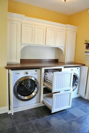 Cottage Laundry Room with laundry sink, Rev-A-Shelf Hamper Bottom Mount Rev-A-Motion with Wire Bins Closet, stone tile floors