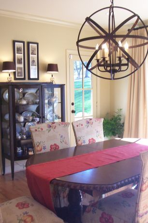 Country Dining Room with specialty window, Crown molding, Standard height, Hardwood floors, French doors, can lights