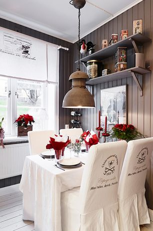 Country Dining Room with Laminate floors, Pendant light, Window seat, European factory long-neck, Built-in bookshelf
