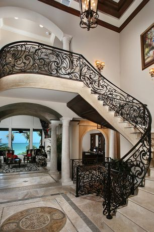 Mediterranean Entryway with Custom stone flooring design, Natural wood molding and ceiling, complex marble floors, Columns