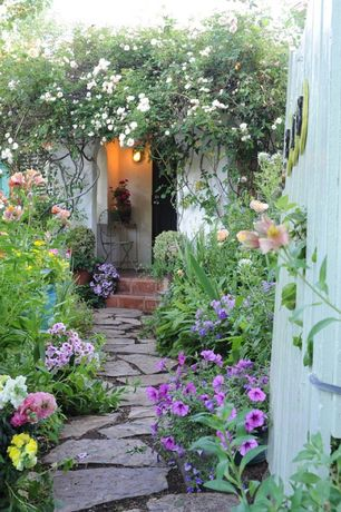 Cottage Landscape/Yard with Flagstone path, Demarforge wrought iron chair, White flower farm white climbing rose