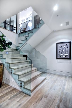 Modern Staircase with Hardwood floors, Glass staircase