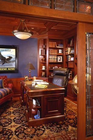 Traditional Home Office with flush light, Chair rail, Standard height, sliding glass door, can lights, Built-in bookshelf