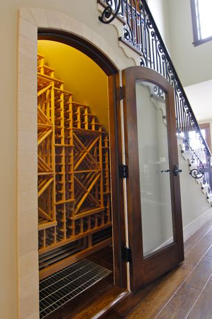 Traditional Wine Cellar with Standard height, Hardwood floors, French doors