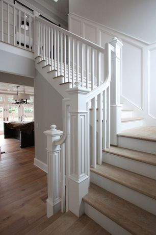Traditional Staircase with Wainscotting, Hardwood floors, Chair rail, High ceiling