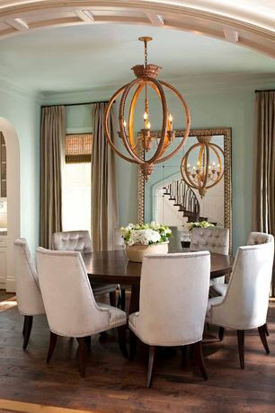 Traditional Dining Room with Crown molding, Bassett Mirror Sazerac Leaner Mirror, Hardwood floors, Chandelier