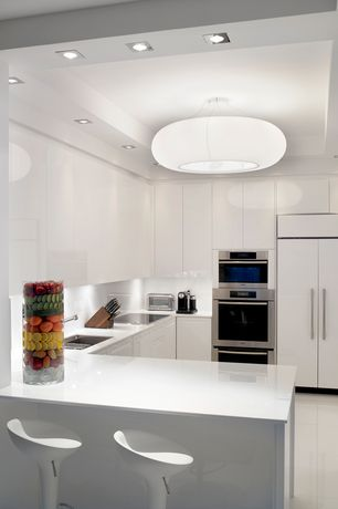 Contemporary Kitchen with Solid surface corian countertop in designer white, Corian counters, large ceramic tile floors