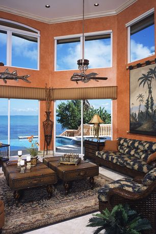 Tropical Living Room with Crown molding, can lights, Ocean club salina sofa, Ceiling fan, Paint 1, picture window, Wallpaper