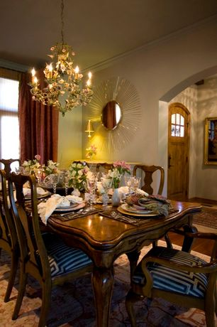 Traditional Dining Room with Carpet, Crown molding, Glass panel door, Chandelier