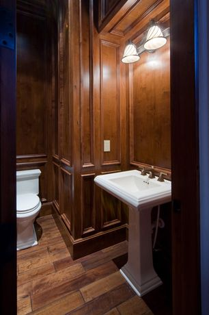 Traditional Powder Room with Powder room, High ceiling, Pedestal sink, Hardwood floors