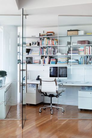 Contemporary Home Office with Glass panel door, Columns, Built-in bookshelf, Hardwood floors