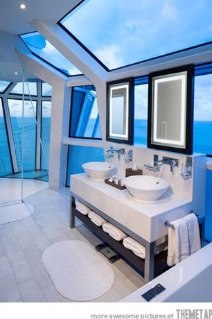 Contemporary Master Bathroom with Nackten bathmat, Skylight, Vessel sink, Handheld showerhead, Double sink, Master bathroom