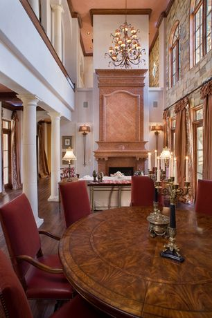 Mediterranean Great Room with Cathedral ceiling, Transom window, Hardwood floors, Chandelier, Loft, Glass panel door, Columns