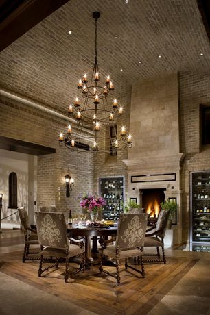 Traditional Dining Room with Hardwood floors, can lights, picture window, Chandelier, Wall sconce, interior brick, Fireplace