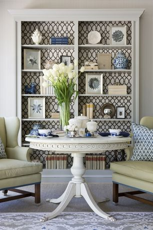 Traditional Living Room with Built-in bookshelf, Carpet, Lattice pattern wallpaper, Wingback armchair, Pedestal dining table