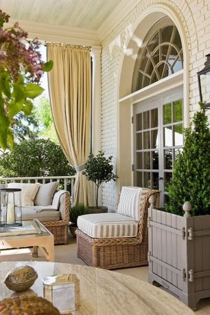 Country Porch with Crown molding, Brick exterior, French doors, Columns, Raised beds, Wall sconce, Transom window