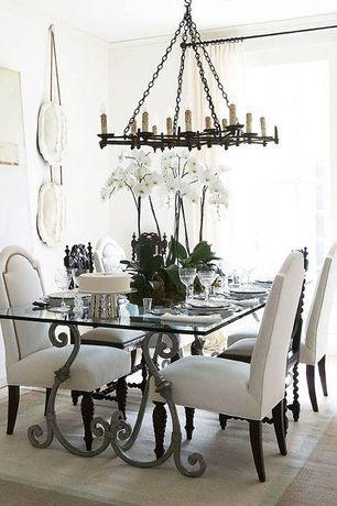 Eclectic Dining Room with Chandelier, Carpet, Standard height