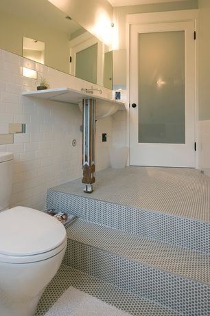 Contemporary Master Bathroom with Merola tile tessera subway ice white 3x6 glass wall tile, penny tile floors, Paint