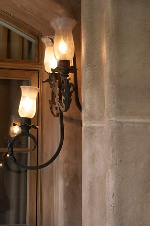 Mediterranean Exterior of Home with Wall sconce