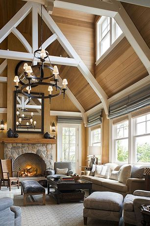Contemporary Great Room with Crown molding, Exposed beam, French doors, High ceiling, Hardwood floors, stone fireplace