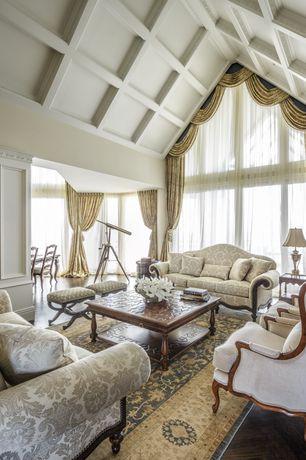 "Traditional Living Room with Hardwood floors, Black frame curule stool, pink upholstered, 9""-11"" BIrds Nest Coral, Columns"