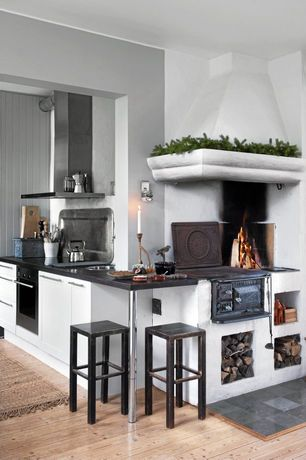 Eclectic Kitchen with Flat panel cabinets, Breakfast bar, electric cooktop, Standard height, stone tile floors, Bristol