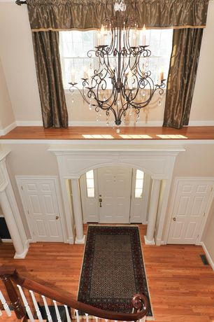 Traditional Entryway with Chandelier, Hardwood floors, Columns, Cathedral ceiling, Built-in bookshelf
