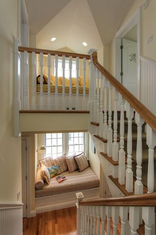 Cottage Staircase with Wainscotting, High ceiling, Hardwood floors, Built-in daybed, Vaulted ceiling