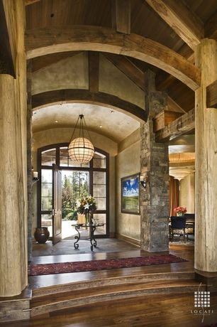 Country Entryway with High ceiling, Arched entry, Exposed beam, Carpet runner, Chandelier, Timber roof support, slate floors