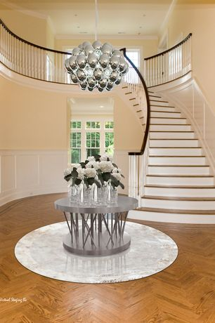Traditional Staircase with Wainscotting, Crown molding, Hardwood floors, High ceiling